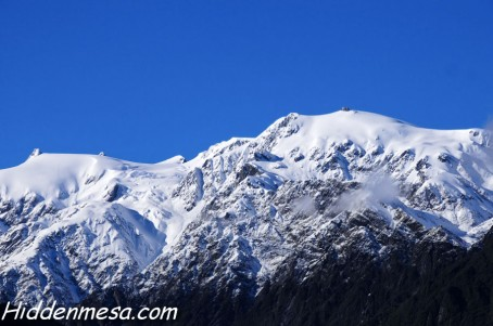 Snow covered mountains near Franz Josef glacier New Zealand. Image by Bonnie Fink