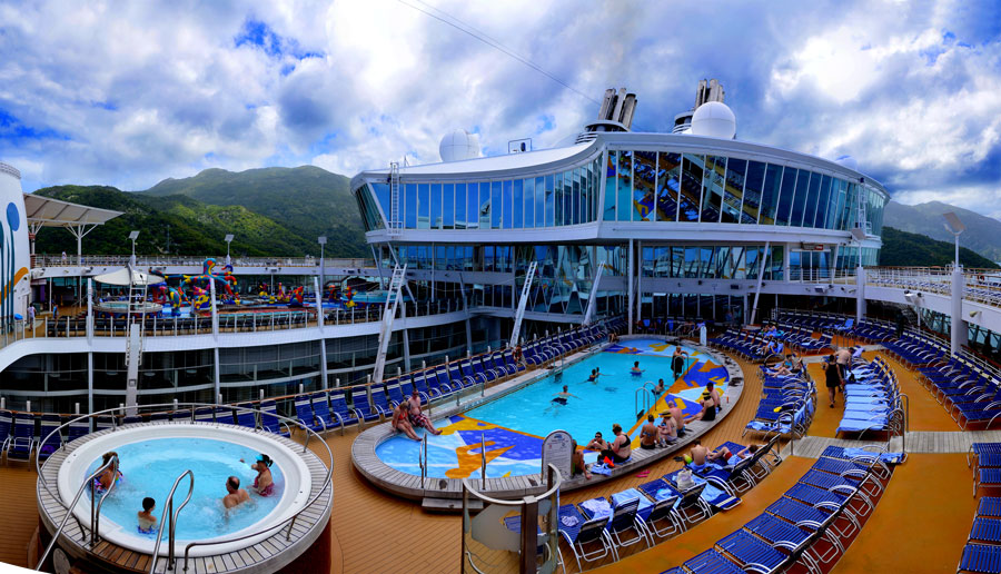 Deck 15 is where the outdoor action is aboard the Allure of the Seas. There are two pools with an open canyon looking down into Central park on Deck 8. Image by Donald Fink