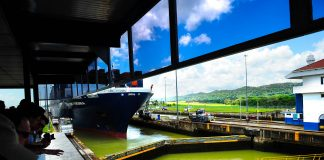 A cargo ship being pulled through the Gatun Locks Panama Canal