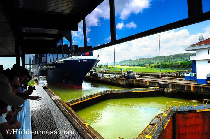 A cargo ship being pulled through the Gatun Locks Panama Canal